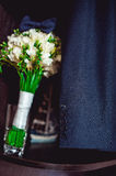 Dark blue bow tie on a luxury bridal bouquet of white flowers on a shelf Royalty Free Stock Image