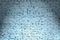 Dark blue brick wall shined from above Royalty Free Stock Photo