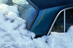 Dark blue car covered with snow drift. Poured under the snow. Inwinter outside stock photos