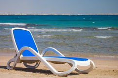 Dark blue chaise lounge at the sea Royalty Free Stock Photo