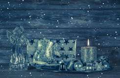 Dark blue christmas decoration with candle and presents on woode Stock Photo