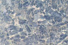 Dark blue close up granite texture pattern surface abstract background. Black stone, pattern for wallpape. R Stock Photography