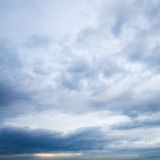 Dark blue clouds in evening sky Stock Image