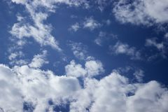 Dark blue cloudy sky stock photo