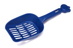 Dark blue colored plastic litter scoop Royalty Free Stock Photo