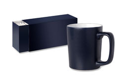 Dark blue cup and tea packaging Royalty Free Stock Photo