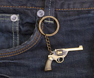 Dark blue denim jeans with a gun Royalty Free Stock Photography