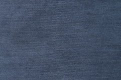 Dark blue, denim texture. Fabric texture of the jeans Stock Photography