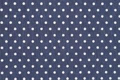 Dark blue denim with white polka dot fabric background Stock Photos