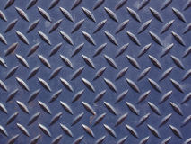 Dark Blue Diamond Plate. Worn steel diamond plate, tinted dark green. Makes a good wallpaper or background stock images