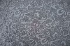 Dark blue fabric with relief floral pattern. From above royalty free stock photos