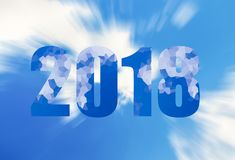Dark blue figures symbol of the new year two thousand eighteen, 2018 with a crystal snow ornament on a background of azure sky. And clouds Stock Photos