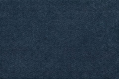 Dark blue fluffy background of soft, fleecy cloth. Texture of light nappy textile, closeup. Navy blue background of soft, fleecy cloth. Texture of light dark stock photo