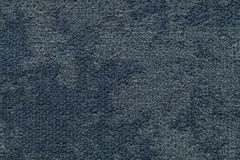 Dark blue fluffy background of soft, fleecy cloth. Texture of light nappy textile, closeup. Stock Images