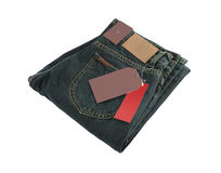 Dark blue folded jeans and blank label Royalty Free Stock Images