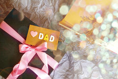 The Dark blue gift box with pink ribbon decoration and Love Dad Stock Images
