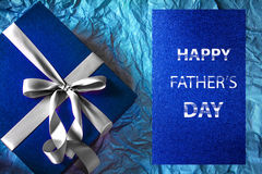 The Dark blue gift box with  ribbon decoration and Happy Father' Royalty Free Stock Photo