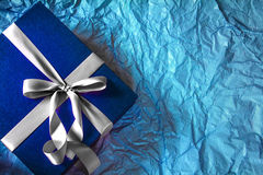 The Dark blue gift box with  ribbon decoration on polka blue pap Stock Photo