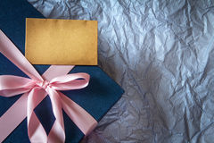 Dark blue gift box with  ribbon decoration on polka blue paper , Royalty Free Stock Photo