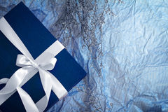 Dark blue gift box with  ribbon decoration  on polka blue paper Stock Photography