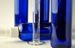Dark blue glass bottles for cosmetic lotions, serums, oils Royalty Free Stock Images