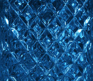 Dark blue glass texture with a pattern of rhombuses. Clear glass diamond shape. Crystals Stock Photos