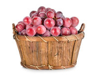 Dark blue grapes in a wooden basket isolated Royalty Free Stock Photo