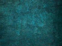 Dark blue green background with black distressed grunge rock or stone texture