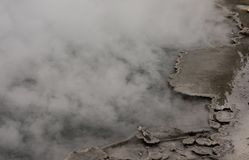 Dark Blue Green Steaming Geyser Pool Edge Detail Yellowstone National Park. Background Royalty Free Stock Photo