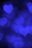 Dark blue heart bokeh background photo, abstract holiday backdrop Royalty Free Stock Image