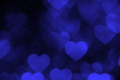 Dark blue heart bokeh background photo, abstract holiday backdrop Stock Photography