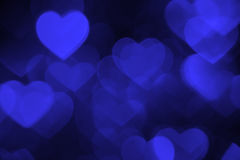 Dark blue heart bokeh background photo, abstract holiday backdrop Royalty Free Stock Photo