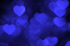 Dark blue heart bokeh background photo, abstract holiday backdrop Royalty Free Stock Images