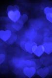 Dark blue heart bokeh background photo, abstract holiday backdrop Royalty Free Stock Photo