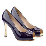 Dark blue high heel shoes isolated on white background. Royalty Free Stock Photography