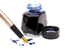 Dark blue ink and gold pen. The isolated dark blue ink, drops and gold pen Stock Photos