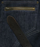 Dark blue jeans. Background texture with zipped pocket and black belt royalty free stock photos