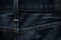 Dark blue jeans fabric background Royalty Free Stock Photography