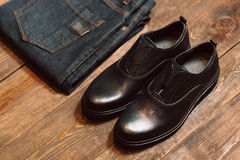 Dark blue jeans and leather shoes Royalty Free Stock Photos