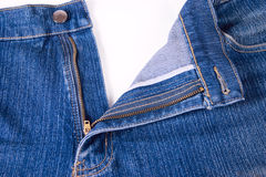 Dark blue jeans with an open fly. Removed close up on a white background. Are not isolated Stock Photos