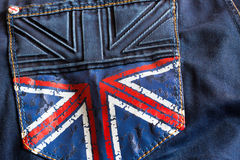 Dark blue jeans with a picture of the British flag on the pocket. Blue jeans with a British flag on the pocket Stock Images
