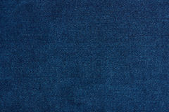 Dark blue jeans texture close up stock image