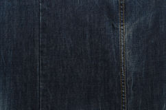 Dark blue jeans texture with seam Royalty Free Stock Photo