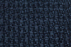 Dark blue knitted woolen background with a pattern of soft, fleecy cloth. Texture of textile closeup. Stock Photos