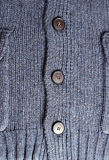 Dark blue knitting woolen pullover with buttons for background Stock Images