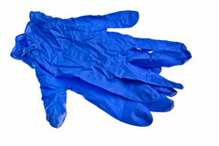 Dark blue latex gloves. Dark blue latex gloves isolated over white background Stock Photography