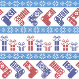 Dark blue, light blue and red Nordic Christmas pattern with stockings, stars, snowflakes, presents, decorative ornaments in scandi Stock Photography