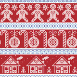 Dark blue, light blue and red Scandinavian nordic seamless pattern with gingerbread man, xmas candy candy cane, gingerbread house,. Xmas trees, heart, baubles Stock Photos