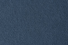 Dark blue lined paper texture background. Macro photo Stock Images