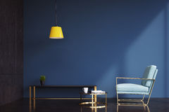 Dark blue living room, armchair. Dark blue living room interior with a navy armchair, a shelf with a potted plant on it and a tiny coffee table. 3d rendering Stock Photography